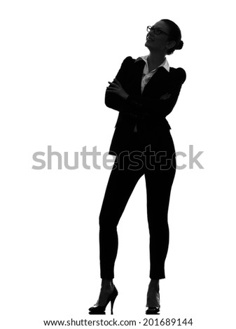 one  business woman standing looking up smiling in silhouette on white background - stock photo