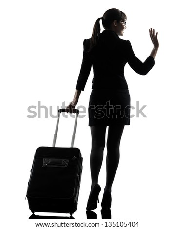 one business woman traveler saluting  rear view  silhouette studio isolated on white background - stock photo
