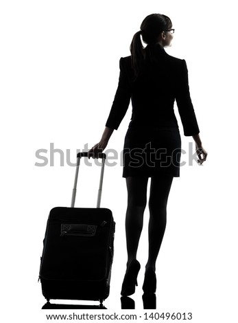 one business woman traveler walking  rear view  silhouette studio isolated on white background