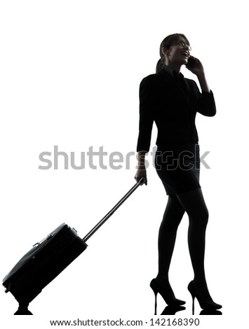 one business woman traveling telephone  silhouette studio isolated on white background