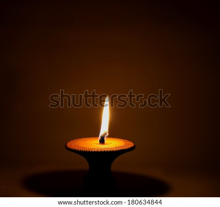 One candle flame at night closeup - isolated - stock photo