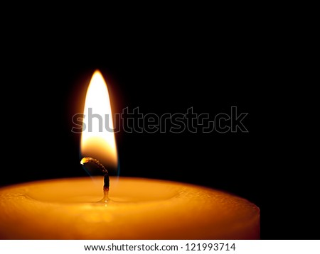 One candle flame at night closeup - isolated, macro. - stock photo