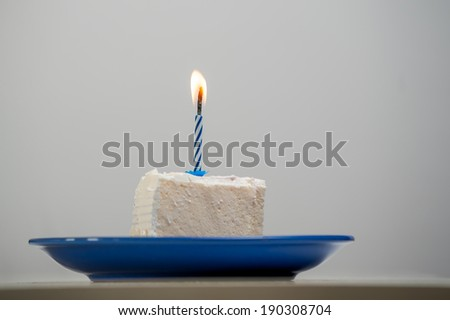 one candle on a cake - stock photo