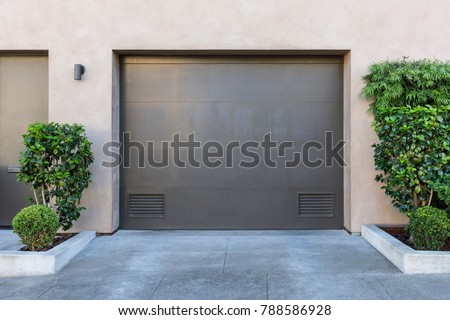 One car garage door, gray garage door with landscape