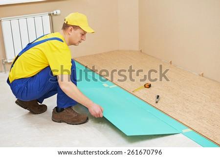 Superb One Carpenter Worker Laying Cork Boards During Indoors Flooring Work