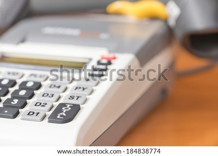 One cash register with a bar code reader - stock photo