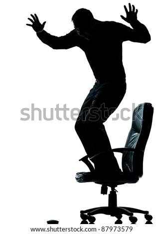 one caucasian business man afraid of computer mouse silhouette Full length in studio isolated on white background - stock photo