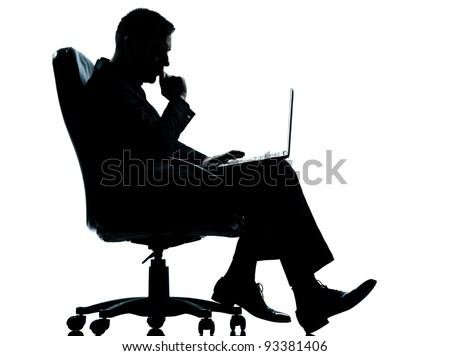 one caucasian business man computer computing serious sitting in armchair silhouette Full length in studio isolated on white background - stock photo