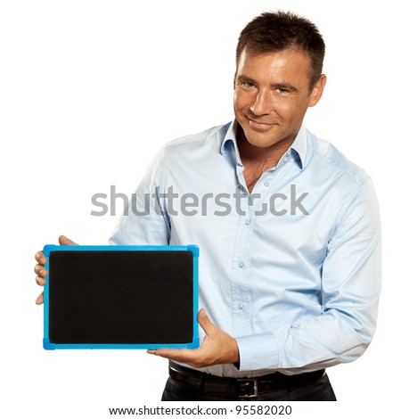 one caucasian business man holding a blackboard copy space message in studio isolated on white background - stock photo
