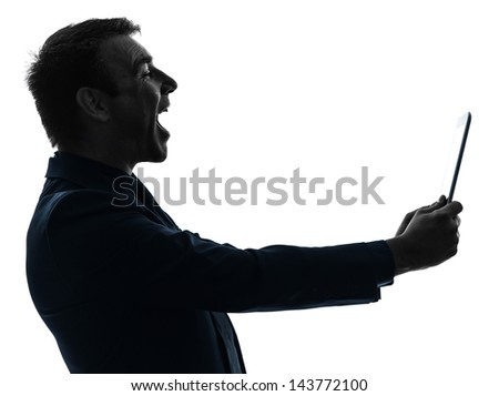 one caucasian business man holding digital tablet  laughing  in silhouette on white background - stock photo
