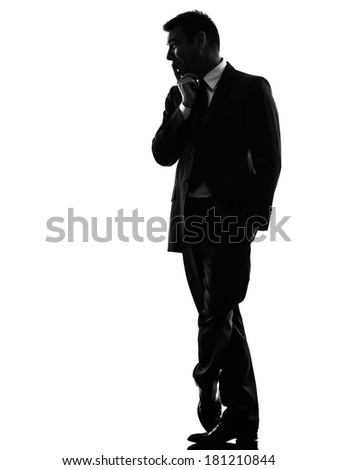 one caucasian business man in silhouette on white background