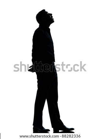 one caucasian business man looking up mouth open  silhouette Full length in studio isolated on white background - stock photo