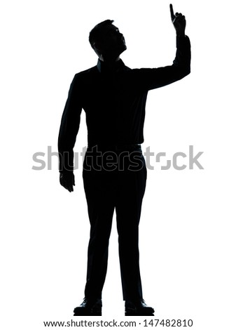 one caucasian business man pointing up happy  silhouette standing Full length in studio isolated on white background