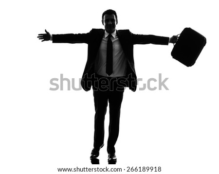 one caucasian business man running happy arms outstretched in silhouette on white background - stock photo