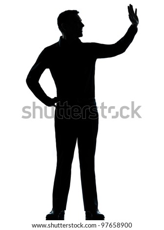 one caucasian business man saluting  silhouette standing Full length in studio isolated on white background - stock photo