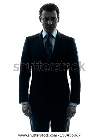 one caucasian business man serious looking at camera  in silhouette studio isolated on white background