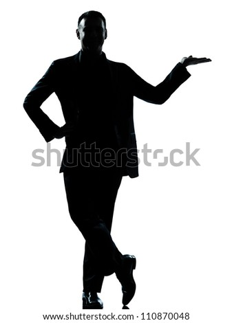 one caucasian business man silhouette standing hand open  Full length in studio isolated on white background - stock photo
