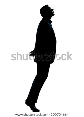 one caucasian business man silhouette standing tiptoe looking up Full length in studio isolated on white background - stock photo