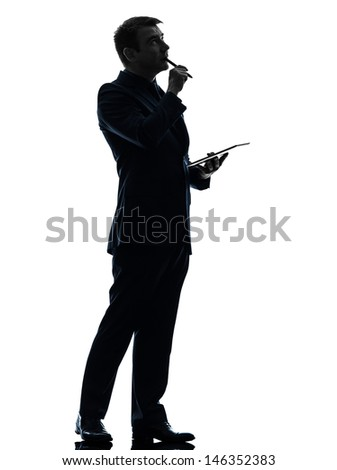 one caucasian business man thinking pensive  holding digital tablet   in silhouette on white background