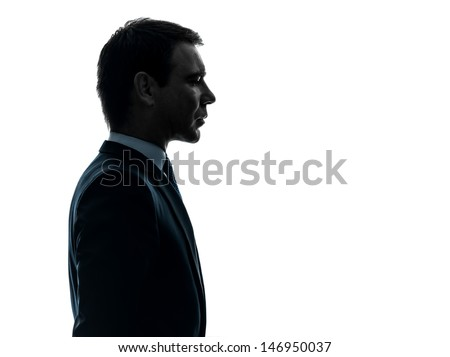 one caucasian business man thinking portrait in silhouette studio isolated on white background