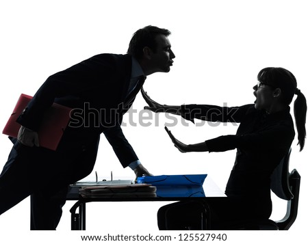 one caucasian business woman man couple sexual harassment in silhouette studio isolated on white background - stock photo