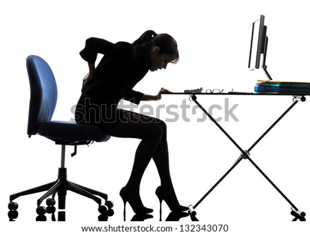 one caucasian business woman sitting backache pain in silhouette studio isolated on white background - stock photo