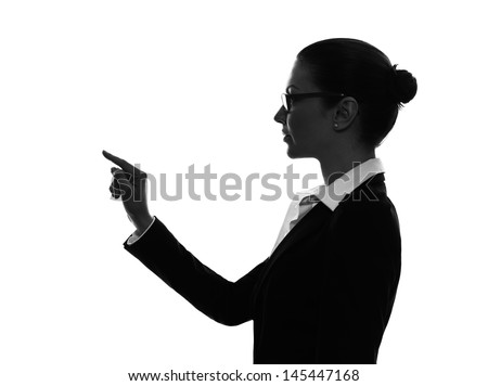 one caucasian business woman touching copy sapce in silhouette  on white background - stock photo