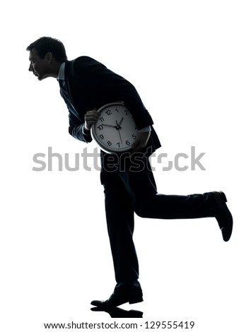 one caucasian businessman holding clock robbing time  in silhouette studio isolated on white background