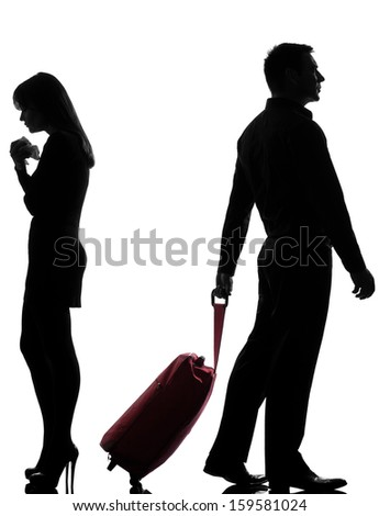 one caucasian couple man and woman dispute separation in studio silhouette isolated on white background - stock photo