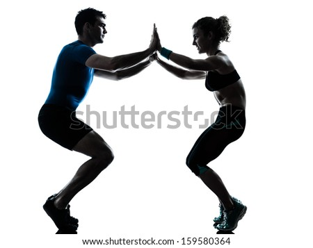 one caucasian couple man woman personal trainer coach exercising squats silhouette studio isolated on white background - stock photo