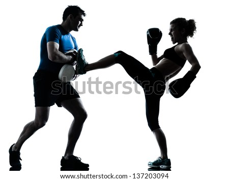 one caucasian couple man woman personal trainer coach man woman boxing training silhouette studio isolated on white background - stock photo