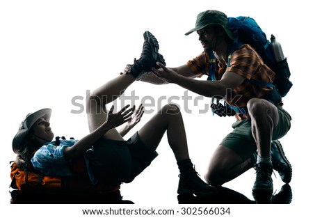 one caucasian couple trekker trekking injury accident nature in silhouette isolated on white background - stock photo