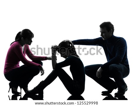 one caucasian family father mother consoling daughter  in silhouette studio isolated on white background - stock photo