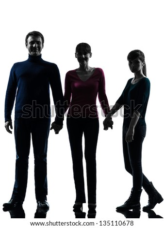 one caucasian family father mother daughter man holding hands in silhouette studio isolated on white background - stock photo