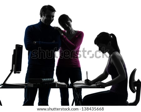 one caucasian family father mother proud satisfaction daughter   homework  in silhouette studio isolated on white background - stock photo