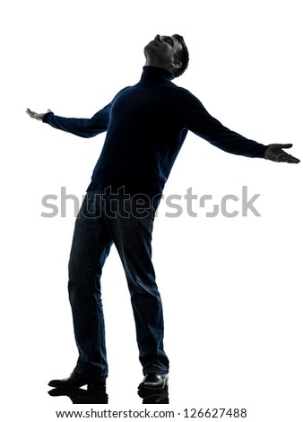 one caucasian happy man looking up full length in silhouette studio isolated on white background - stock photo