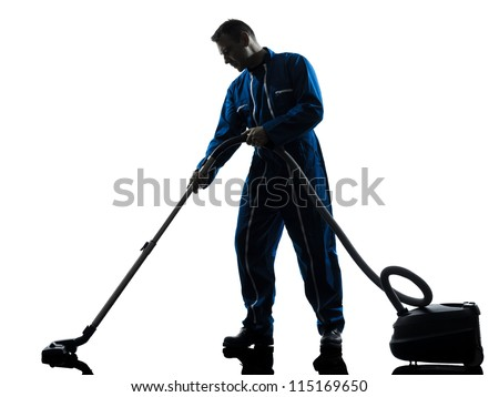 one caucasian janitor vaccum cleaner cleaning silhouette in studio on white background - stock photo