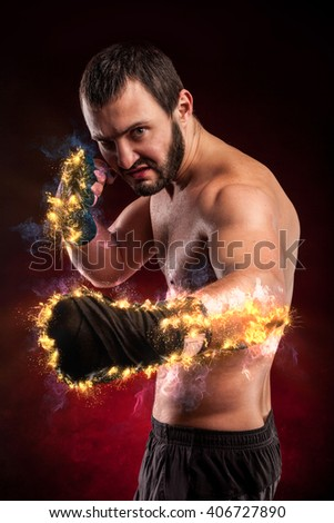 one caucasian man exercising boxing with fire arms  - stock photo