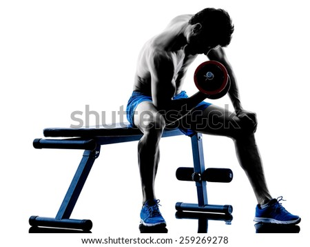 one caucasian man exercising fitness weights Bench Press exercises in studio silhouette isolated on white background - stock photo