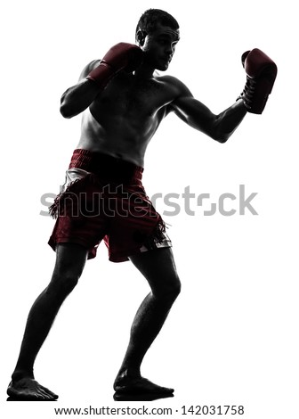 one caucasian man exercising thai boxing in silhouette studio  on white background - stock photo