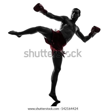 one caucasian man exercising thai boxing in silhouette studio  on white background - stock photo