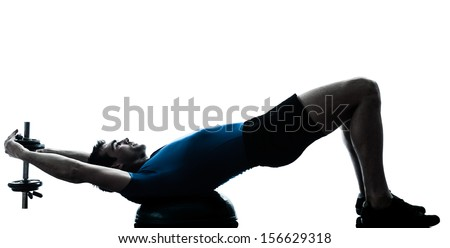 one caucasian man exercising weight training on bosu workout fitness in silhouette studio  isolated on white background - stock photo