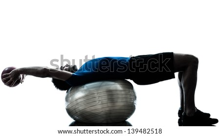 one caucasian man exercising workout fitness ball in silhouette studio  isolated on white background