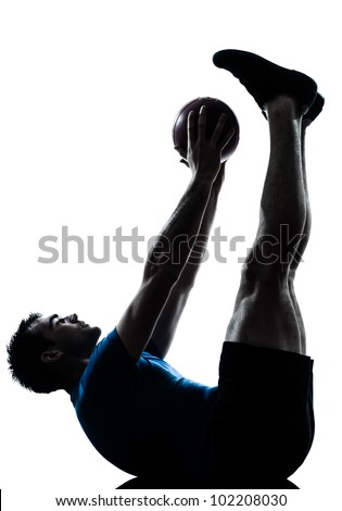 one caucasian man exercising workout holding fitness ball posture in silhouette studio  isolated on white background - stock photo