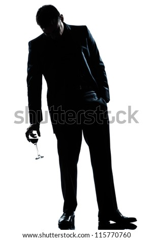 one caucasian man full length silhouette  drunk holding a glass of red wine in studio isolated white background - stock photo