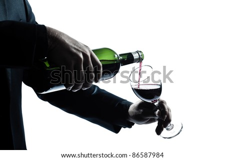 one caucasian man hands detail pouring red wine in a glass silhouette in studio isolated white background - stock photo