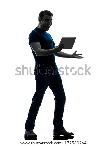 one caucasian man holding watching digital tablet  in silhouette on white background - stock photo
