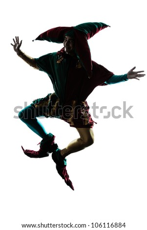 one caucasian man in jester costume jumping silhouette in studio isolated on white background - stock photo