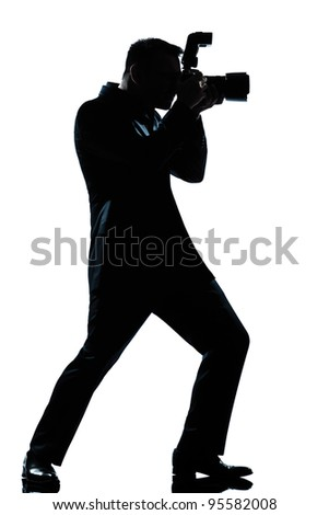 one caucasian man photographer full length silhouette in studio isolated white background - stock photo