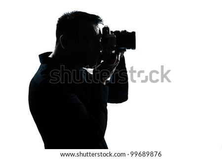 one caucasian man portrait silhouette photographer in studio isolated on white background